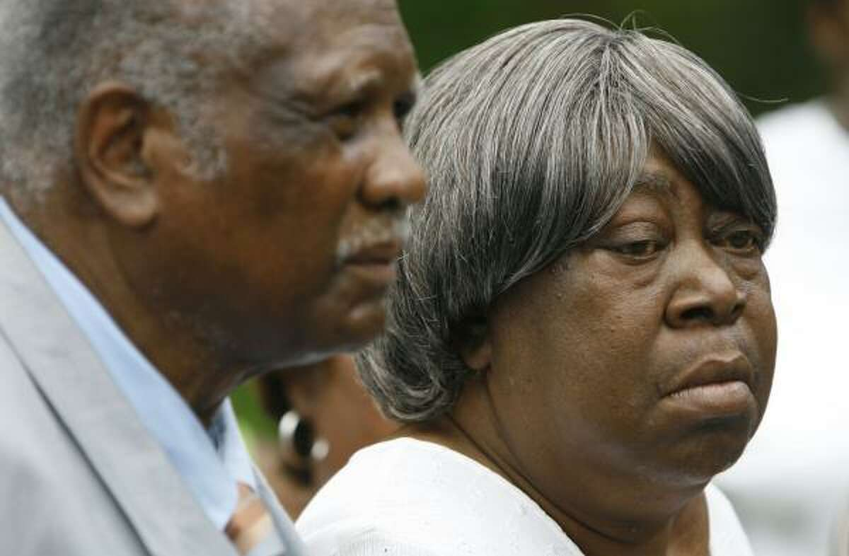 Tommy Junious and his wife, Rilla, attend a press conference at Mount Pilgrim Rest Baptist Church in Acres Homes on Thursday to show support for their son Bilford Dwight Junious, who awaits trial in seven rapes. No evidence has connected him to the slayings, police say.