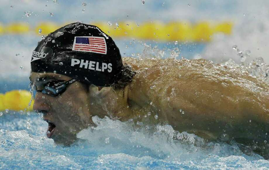 U.S. Michael Phelps swims on his way to winning the gold medal in the men's 100m Butterfly final at the FINA Swimming World Championships in Shanghai, China, Saturday, July 30, 2011.  (AP Photo/Michael Sohn) Photo: Michael Sohn, STF / AP