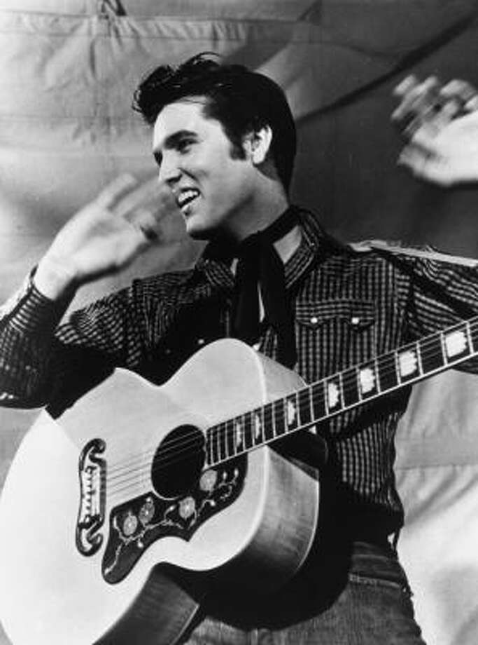 Presley is shown with his Gibson J-200 guitar in 1957. Photo: MGM STUDIOS   ASSOCIATED PRESS