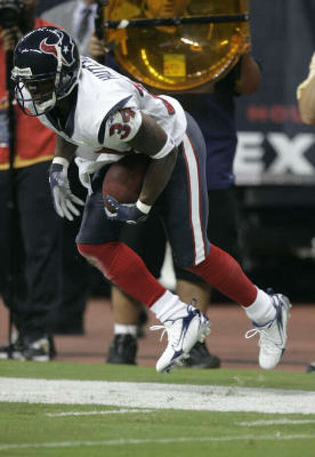 Von Hutchins (shown after Saturday's interception of Brian Griese) could be headed for the starting job at free safety, but the Texans invited four DBs to try out. Photo: Brett Coomer, Chronicle