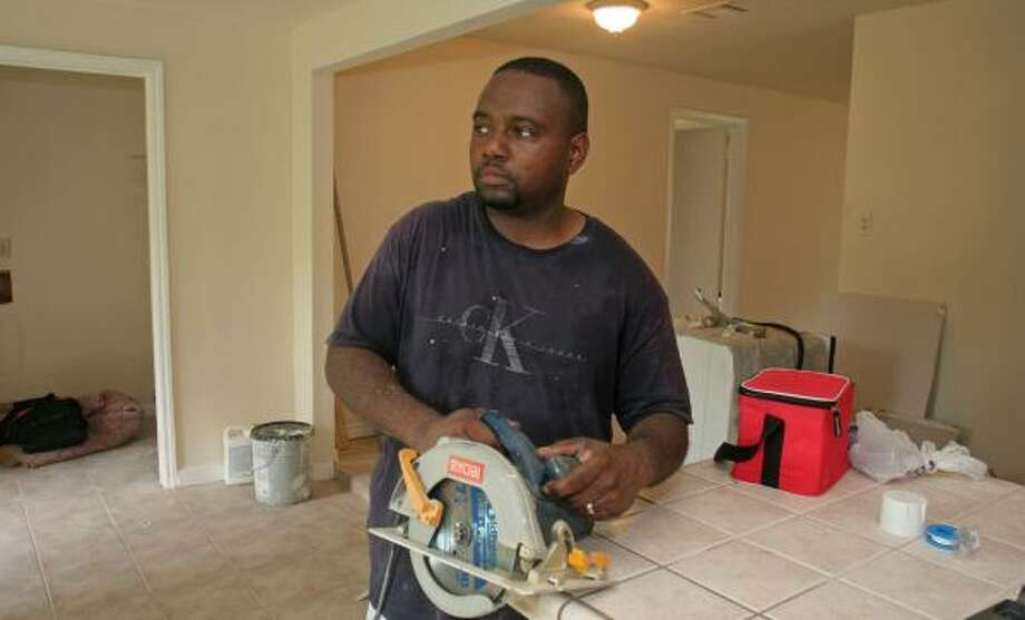 Roshawn Hall has to work three jobs, including one fixing up properties, to help pay his mortgage. Hall and his family are trying to refinance his family's home after their monthly payments rose $800. Photo: GARY FOUNTAIN, FOR THE CHRONICLE