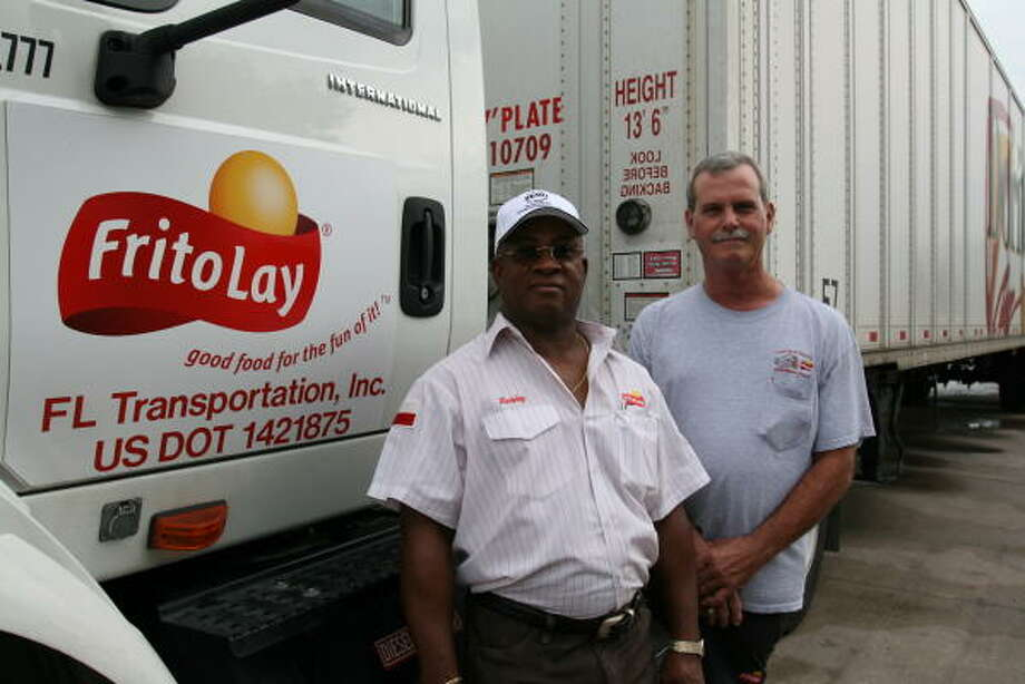 The Frito-Lay North America Fleet Team recognized local drivers from left, Bobby Dickerson, 57, of East Bernard for completing one million miles and Tom Key, 53, of Damon for completing two million miles. Photo: Suzanne Rehak, For The Chronicle