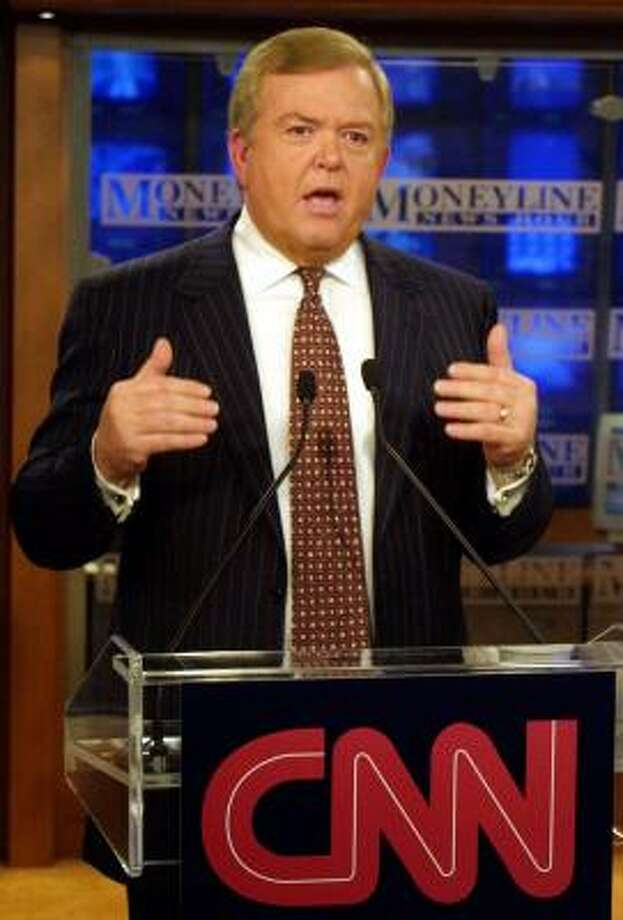 CNN business news anchor Lou Dobbs addresses the media in New York in this April 2001 file photo. Photo: SYLVAIN GABOURY, ASSOCIATED PRESS