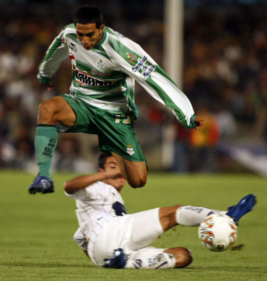 Edgar Castillo (in green) is one of the U.S. born or -groomed players in the 18-team Mexican First Division for 2008. Photo: OMAR TORRES, AFP/Getty Images