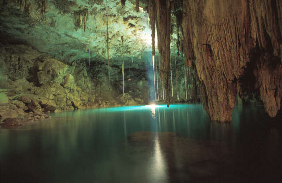 More than 3,000 cenotes, or geologic sinkholes, dot the landscape in the Yucatán. They offer opportunities for scuba diving and snorkeling. Photo: Texas Tourism Board