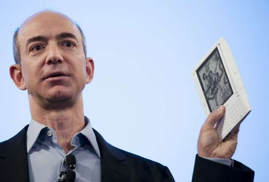Jeff Bezos, founder and CEO of Amazon.com, introduces the Kindle wireless reading device in November. Fast-growing international sales boosted the online retailer's profit. Photo: Mark Lennihan, ASSOCIATED PRESS FILE