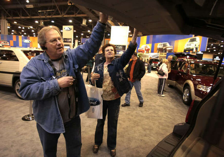 Fred and Toni Fleming take a serious look at the new 2008 Ford Escape Hybrid on Sunday at the Houston Auto Show at Reliant Park. Photo: Billy Smith II, CHRONICLE