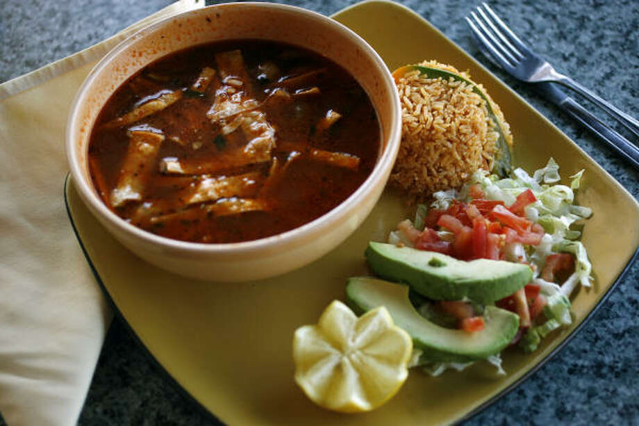 The tortilla soup is a tasty attraction as a starter, a side dish or a main course. Photo: Todd Spoth, For The Chronicle