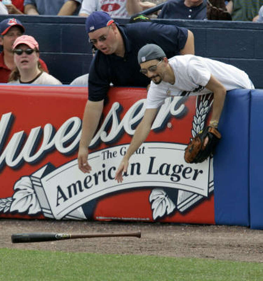 Astros infielder Tomas Perez's bat went flying during an exhibition loss to host Cleveland. Photo: Tony Dejak, AP