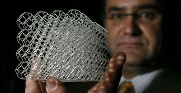 No bones about itRice bioengineer Antonios Mikos (pictured with his model) invented a honeycomb structure that is being used to regrow bone tissue using stem cells. The U.S. Department of Defense awarded a grant to Rice and the UT Health