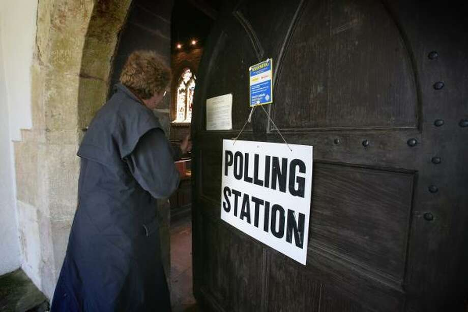 A voter enters a polling place Thursday in St. Nicholas' church in Gloucestershire, England. Photo: MATT CARDY, GETTY IMAGES