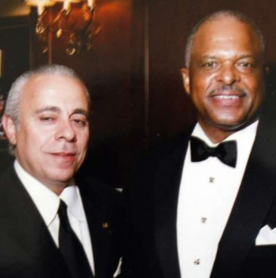Roland Carnaby, seen with Police Chief Harold Hurtt, attended a policeman's ball last year. Photo:  ., HANDOUT