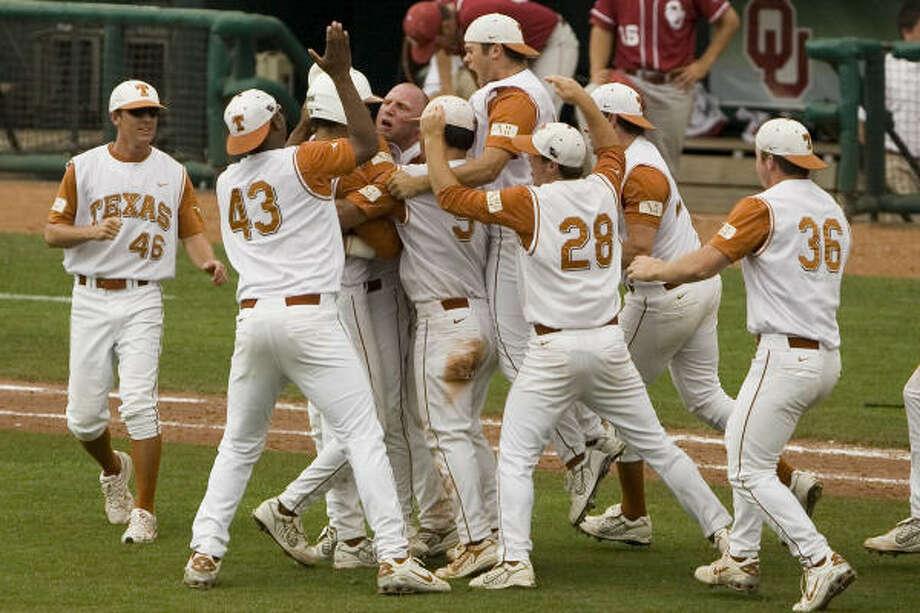 Texas players celebrate Saturday's 11-10 victory over Oklahoma in the Big 12 baseball tournament. Photo: Alonzo Adams, AP