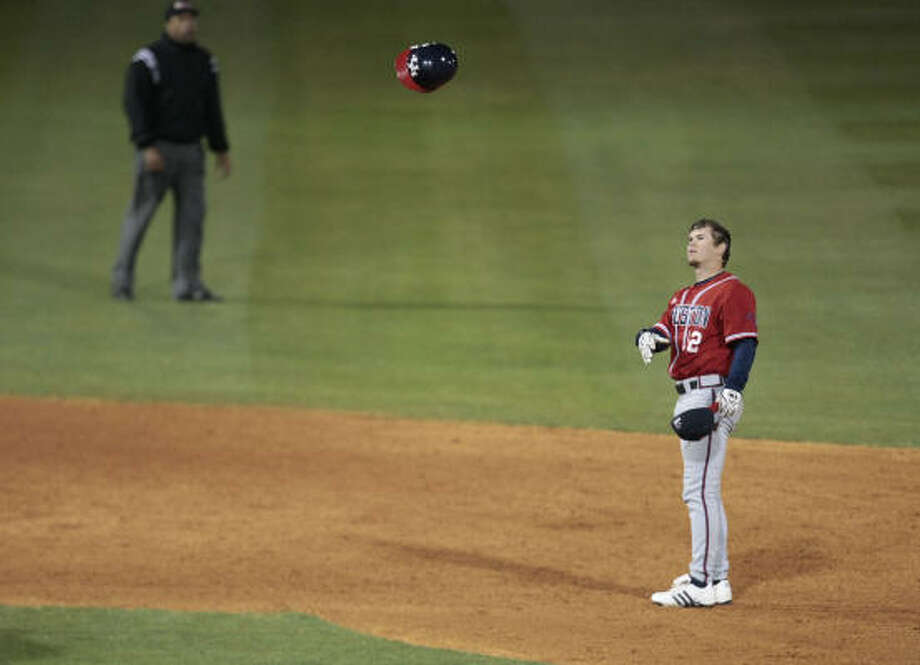 University of Houston's Jake Stewart tosses his batting helmet in the air after getting thrown out by the Rice Owls at second base for the Cougars final out in the top of the ninth inning in this February 27, 2008 file photo. Stewart may have lost his helmet but he never lost his love for baseball, and maybe that's why his story has a happy ending. Photo: Billy Smith II, Houston Chronicle