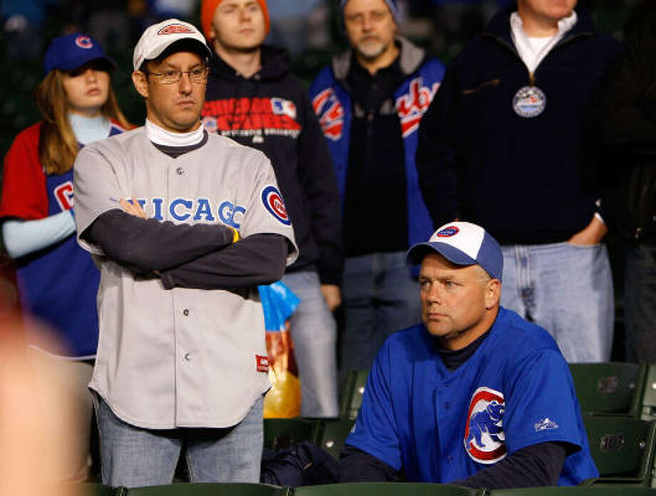 Perhaps a trip to sunny L.A. could improve the disposition of these glum Cubs fans. Photo: Jamie Squire, Getty Images