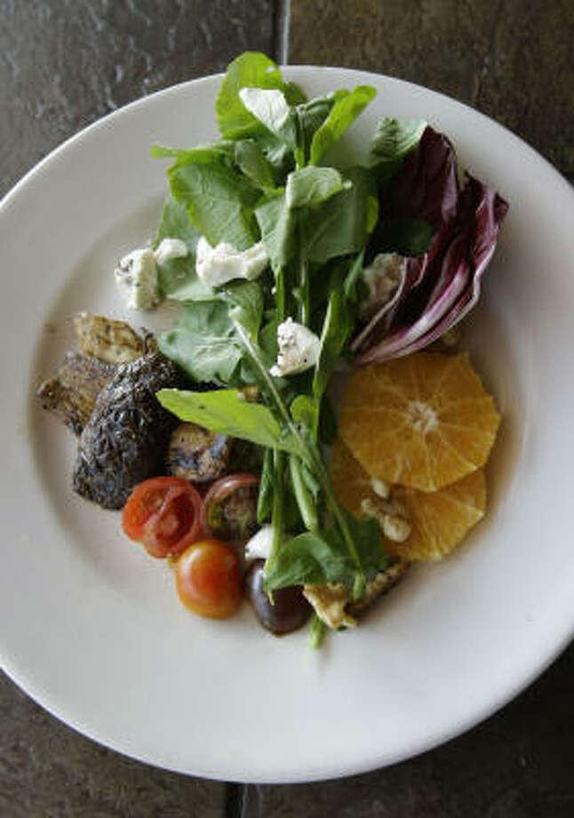 Porchino Mushroom Salad with arugula, radicchio, blood orange and goat cheese is on chef-owner John Watts' menu at Prego. Photo: KAREN WARREN:, CHRONICLE