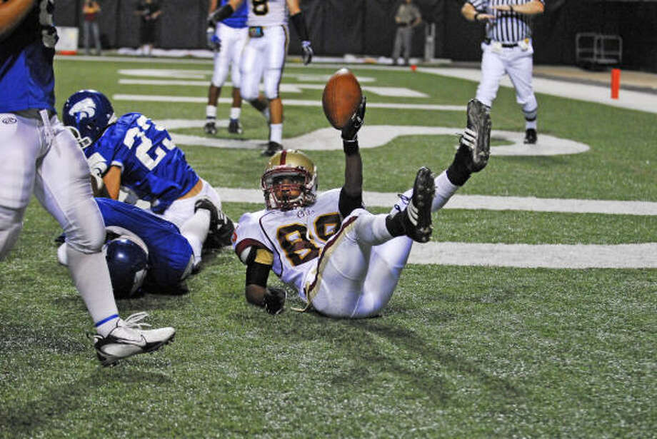 Cy Woods' Patrick LaFleur (89) holds the ball up after a reception against Cy Creek. LaFleur is one of seven Cy Woods receivers with more than 10 catches this season. Photo: Tony Bullard, For The Chronicle