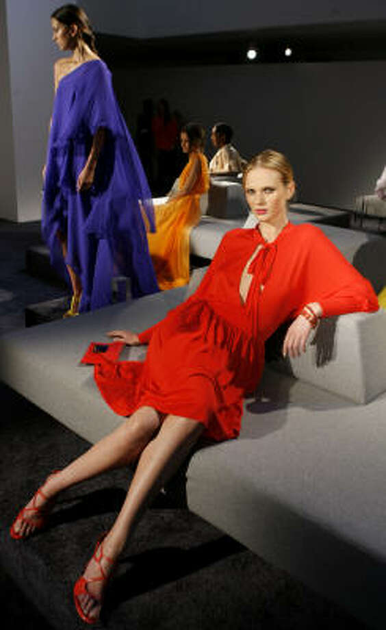 WHAT BEIGE?: Despite pale runway looks,  expect bold colors like these from Halston, in stores. Photo: Jason DeCrow, Associated Press