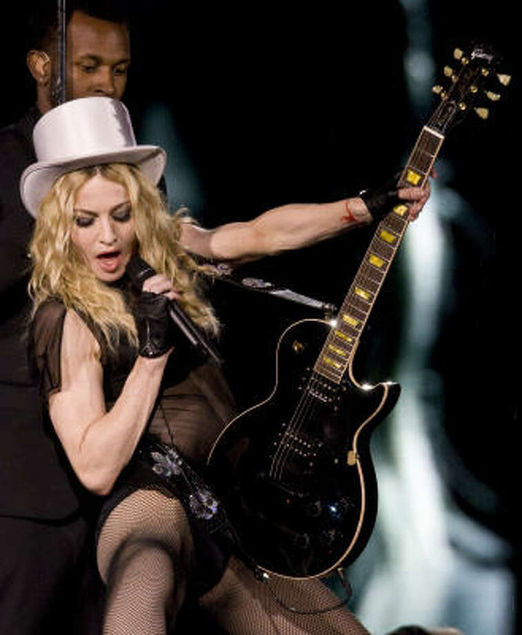 "Madonna performs during her ""Sticky and Sweet"" tour. Photo: ANTONIO SCORZA, AFP 