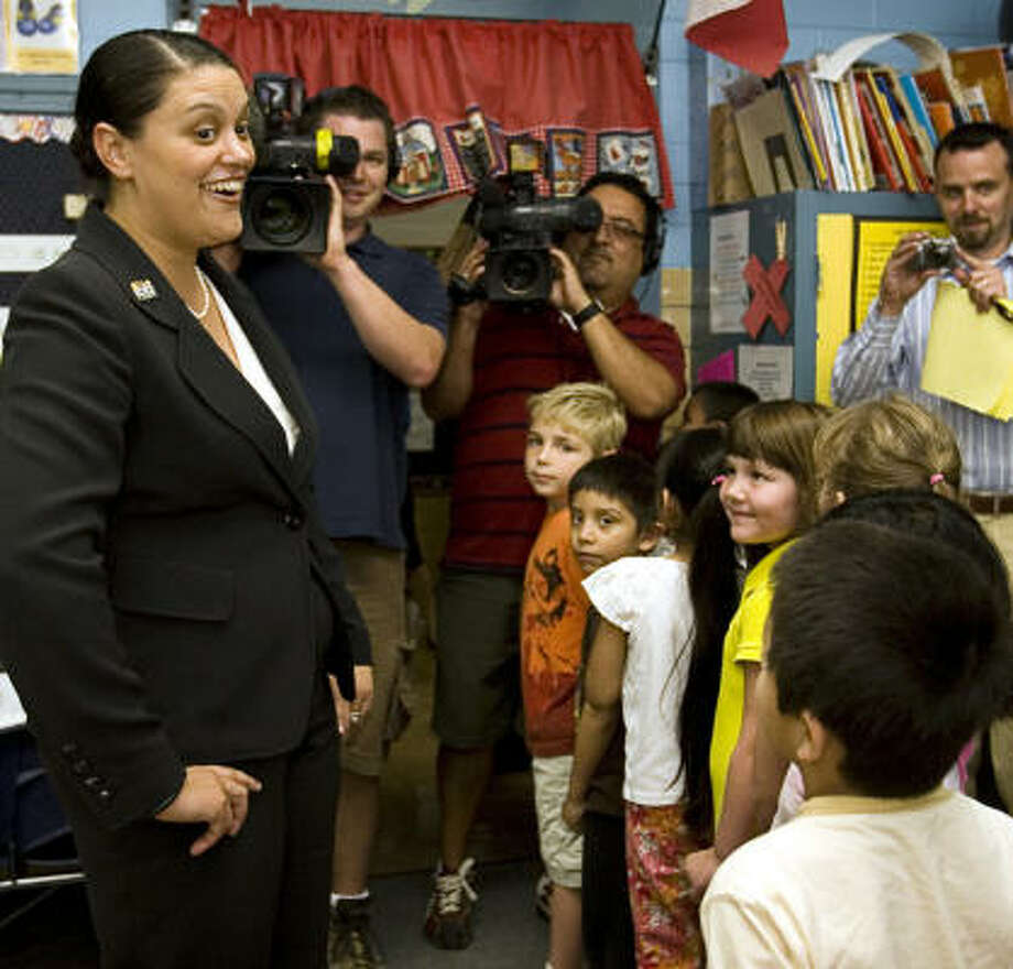 Meria Carstarphen greets pupils in Austin. The process of picking a new superintendent, or the prospect of having a popular one lured away, is always a big story. Photo: Jay Janner, AP
