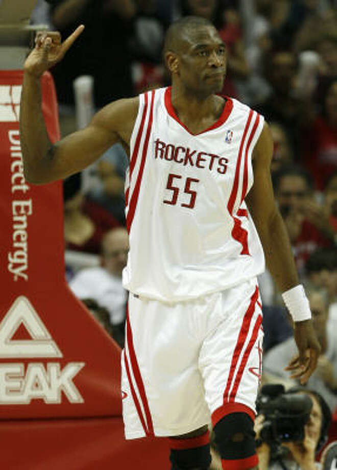 Rockets center Dikembe Mutombo's trademark was wagging his finger after blocking a shot. Photo: Brett Coomer, Chronicle