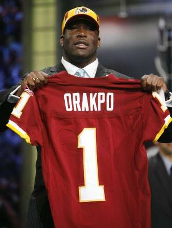 Former University of Texas and Lamar High School star defensive end Brian Orakpo will ply his trade in the NFL for Washington, which took him with the 13th overall pick on Saturday. Photo: Jason DeCrow, AP