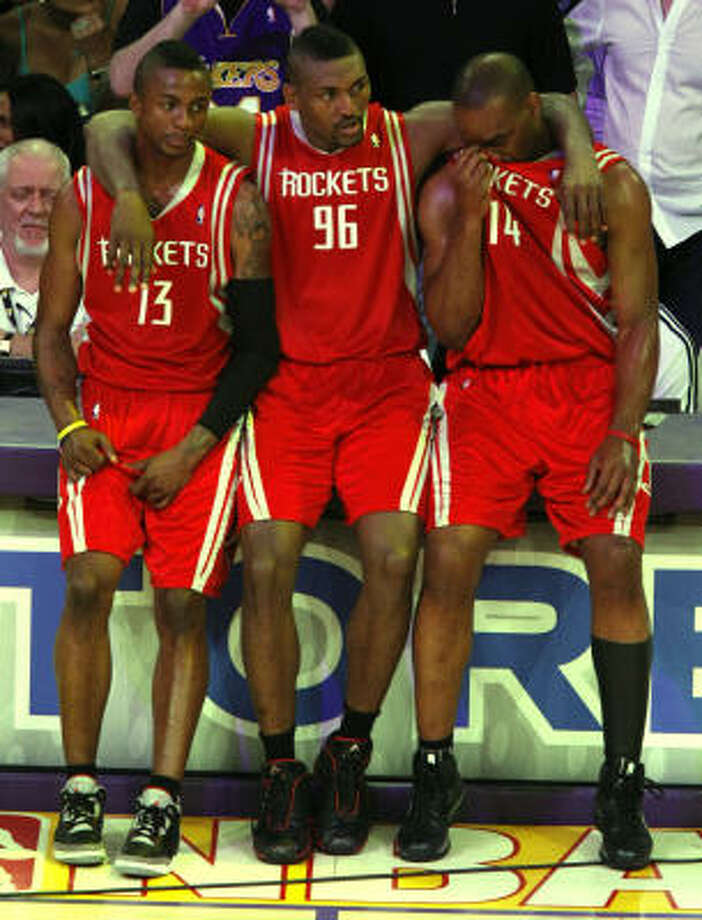 Ron Artest, center, supports teammates Von Wafer, left, and Carl Landry at the end of a disappointing 89-70 Game 7 loss to the Lakers on Sunday at Los Angeles. Photo: Brett Coomer, Chronicle