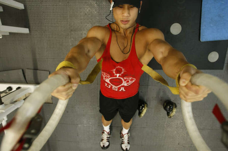 Tuan Tran, 26, of Houston, works out at BONA Fitness on June 1 in Houston. Tran says he's built his muscle naturally. Photo: Julio Cortez, Chronicle