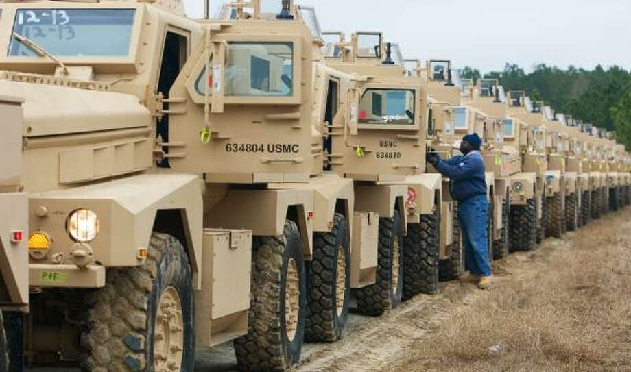 Hundreds of new MRAP vehicles are started up in Charleston, S.C., last month to be loaded onto a transport ship. The vehicles are designed to repel improvised explosive devises. The trucks have been named the top acquisition priority years after the initial request was denied. Photo: PAUL J. RICHARDS, AFP/GETTY IMAGES