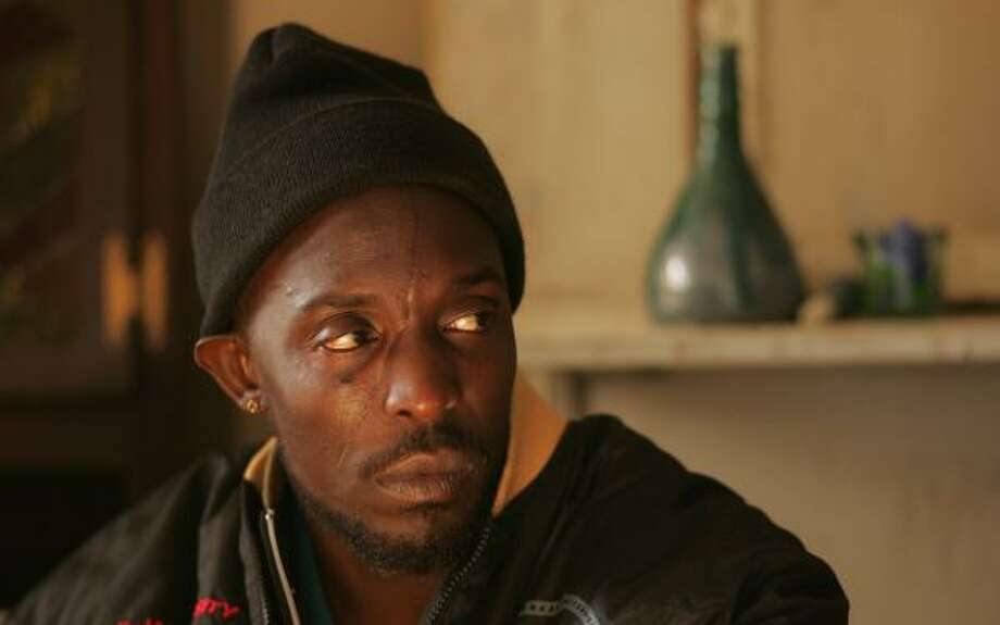 Stickup artist Omar Little (played by Michael K. Williams) was dispatched in shocking fashion Sunday when he took a bullet to the back of the head while buying a pack of cigarettes. His killer? A 12-year-old boy from a rival gang. Photo: PAUL SCHIRALDI, HBO/ASSOCIATED PRESS