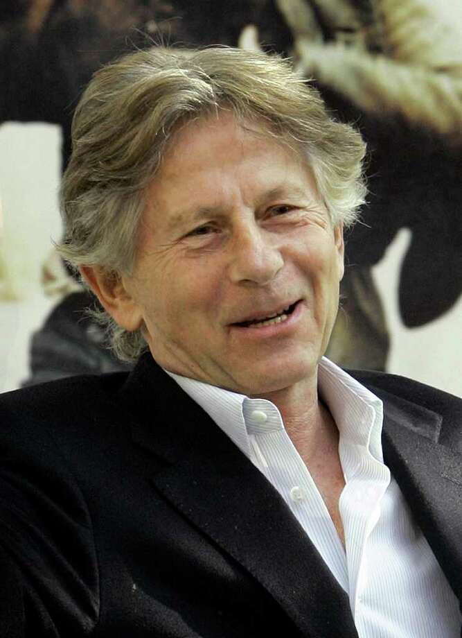 "FILE - I this Nov. 29, 2005 file photo, Polish film director Roman Polanski waves during a photocall for his latest film ""Oliver Twist"" in Madrid, Spain. Polanski's ""Carnage"" will open the 49th annual New York Film Festival beginning Sept. 30, 2011. (AP Photo/Bernat Armangue, file) Photo: BERNAT ARMANGUE"
