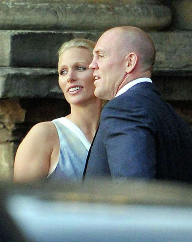 Zara Phillips and Mike Tindall arrive back at the Palace of Holyroodhouse in Edinburgh  Scotland,  Friday July 29 2011.   A regal supporting cast is expected as the queen leads her extended brood to Edinburgh, Scotland for the wedding of the couple Saturday. Prince William and Kate Middleton, now the Duke and Duchess of Cambridge, are expected, along with Prince Harry (still single) and bright lights from Britain's sports and show business worlds. (AP Photo/ Tim Ireland /PA)UNITED KINGDOM OUT - NO SALES - NO ARCHIVES Photo: Tim Ireland / PA