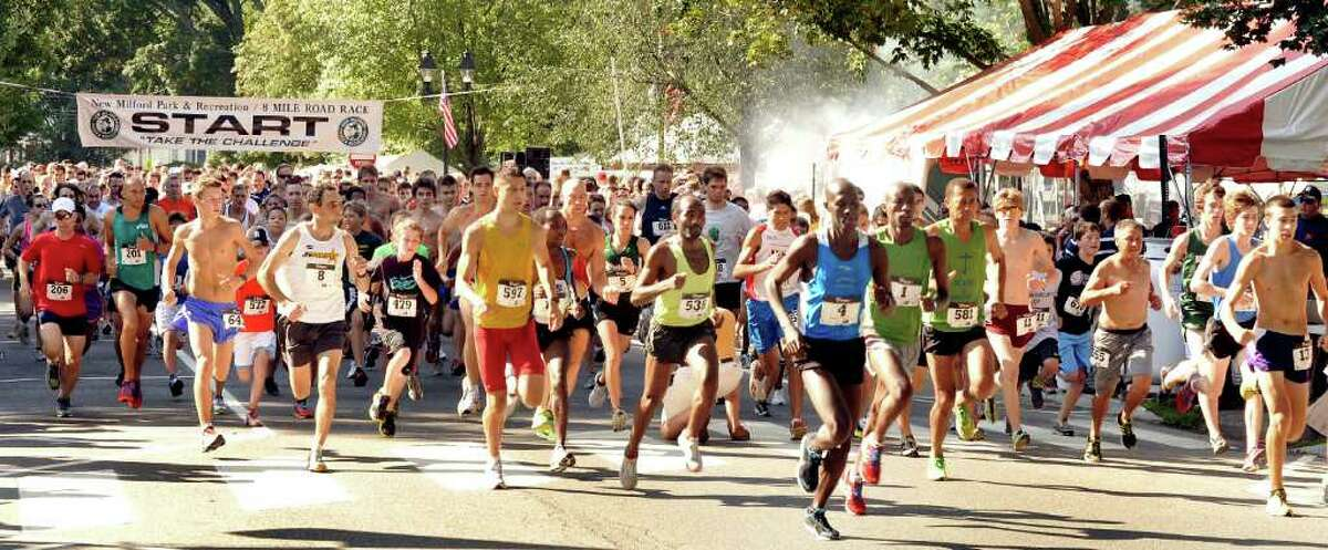 Runners start The New Milford 8-mile and 5K road race during Village Fair Days in New Milford, Saturday, July 30, 2011.