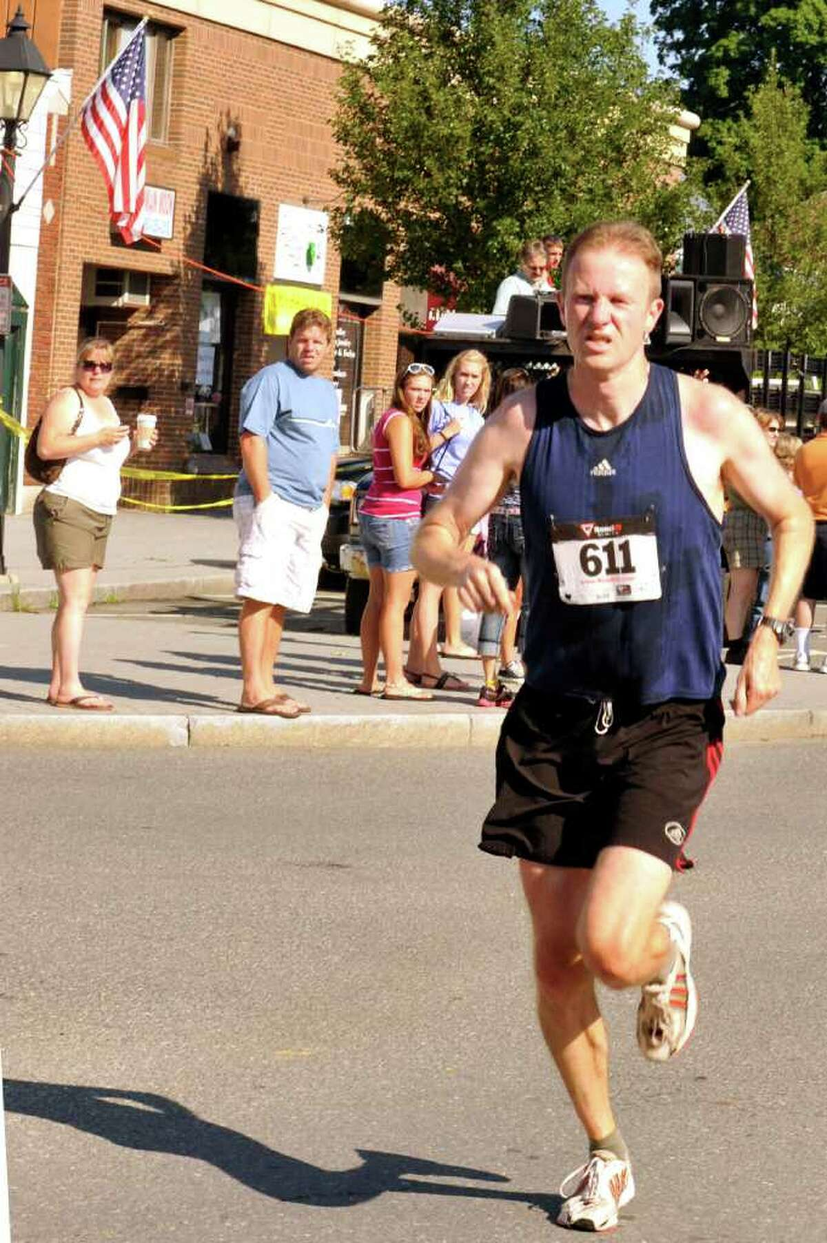 Joe LeMay of Danbury wins The New Milford 5K road race during Village Fair Days in New Milford, Saturday, July 30, 2011.