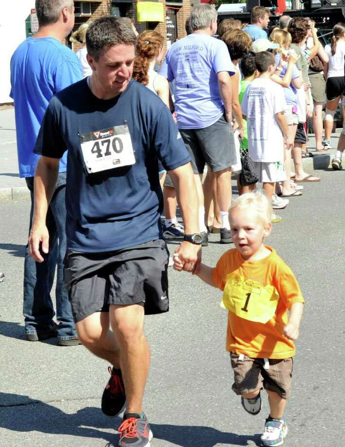 The New Milford 5K road race during Village Fair Days is held in New Milford, Saturday, July 30, 2011. Photo: Michael Duffy