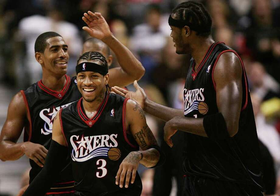 TORONTO - NOVEMBER 8:  (L-R) Kevin Ollie #12, Allen Iverson #3 and Samuel Dalembert #1 of the Philadelphia 76ers share a laugh during the game against the Toronto Raptors  on November 8, 2006 at the Air Canada Centre in Toronto, Canada. The Raptors defeated the Sixers 106-104. NOTE TO USER: User expressly acknowledges and agrees that, by downloading and or using this photograph, User is consenting to the terms and conditions of the Getty Images License Agreement.  (Photo by Harry How/Getty Images) Photo: Harry How, Getty Images / 2006 Getty Images