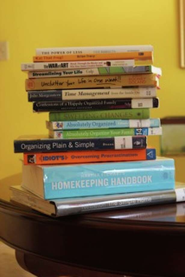 Books can both contribute to and provide answers for your household clutter issues.