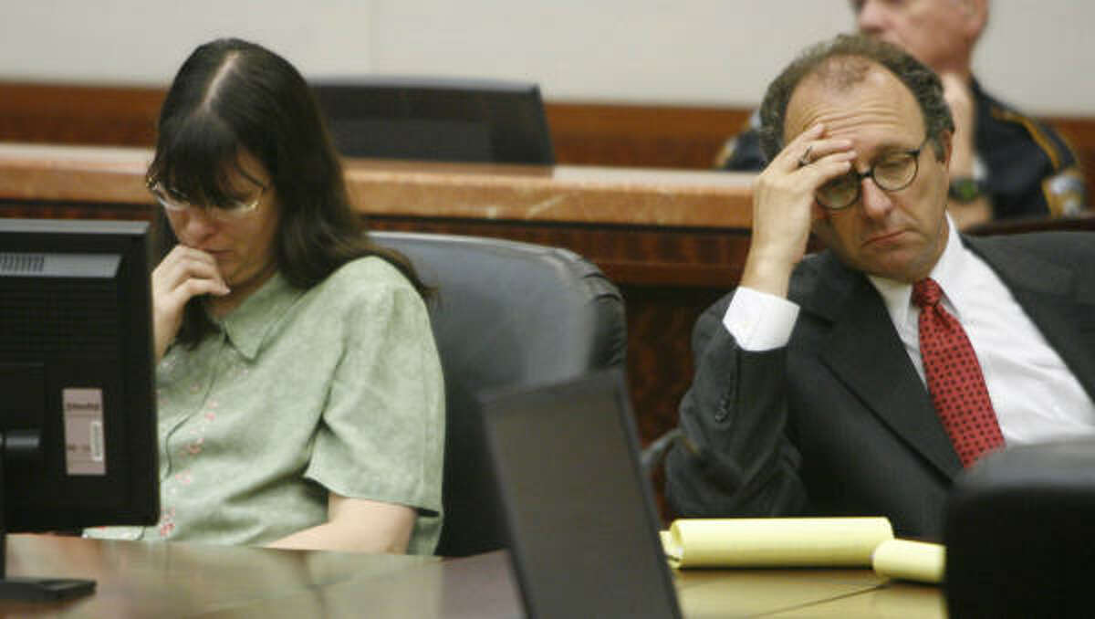 Andrea Yates, left, sits at the defense table with Wendell Odom during the closing arguments in her capital murder trial.