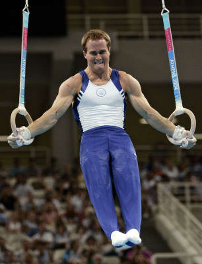 Paul Hamm competes on the rings during the men's gymnastics individual all-around final at the Athens Olympics. Photo: KEVORK DJANSEZIAN, AP