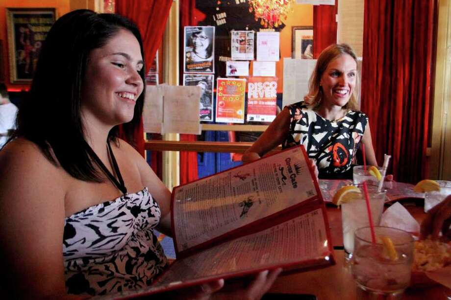 Kristi Lynn Gustafson, age 15 of Michigan, left, and Kristi Lynn Gustafson, of New York, right, sit at a table at the Circus Cafe, Saratoga on Monday, July 18, 2011. (Erin Colligan / Special To The Times Union)