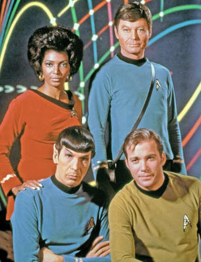Nichelle Nichols, clockwise from rear left, DeForest Kelley, William Shatner and Leonard Nimoy starred in the original Star Trek series. Photo: Chronicle File