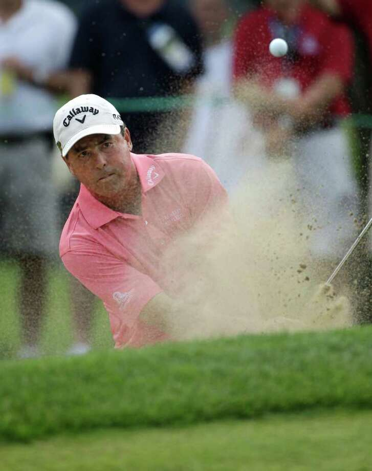 Olin Browne hits out of the sand next to the eighth green during the third round of the U.S. Senior Open golf tournament at the Inverness Club in Toledo, Ohio, Saturday, July 30, 2011. (AP Photo/Carlos Osorio) Photo: Carlos Osorio, STF / AP