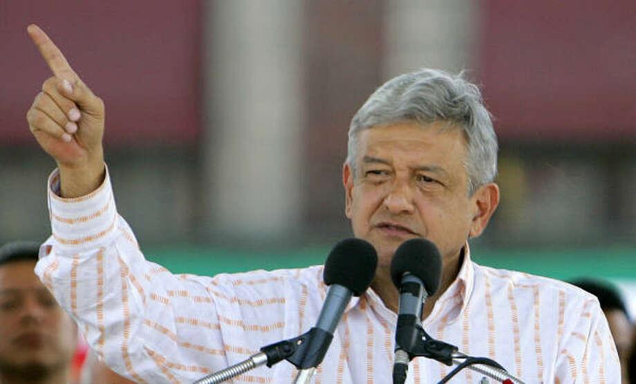 Andres Manuel Lopez Obrador addresses his supporters in Mexico City on Friday. Photo: EDUARDO VERDUGO, AP