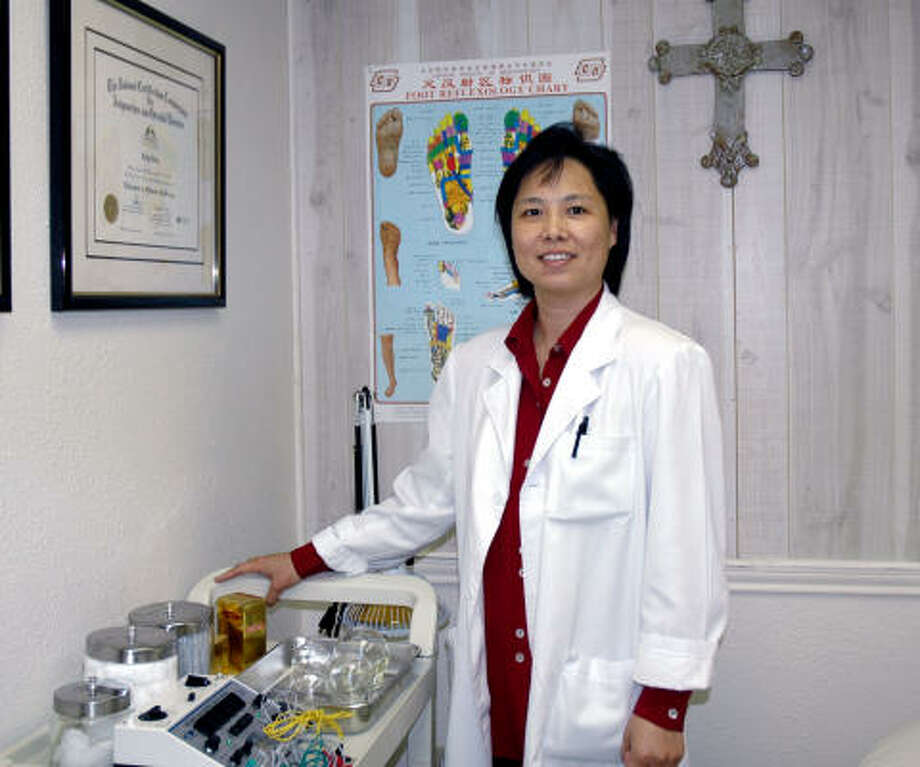 Friendswood's Dr. Lilly Chan in her office. Photo: Wendy Rudnicki, For The Chronicle