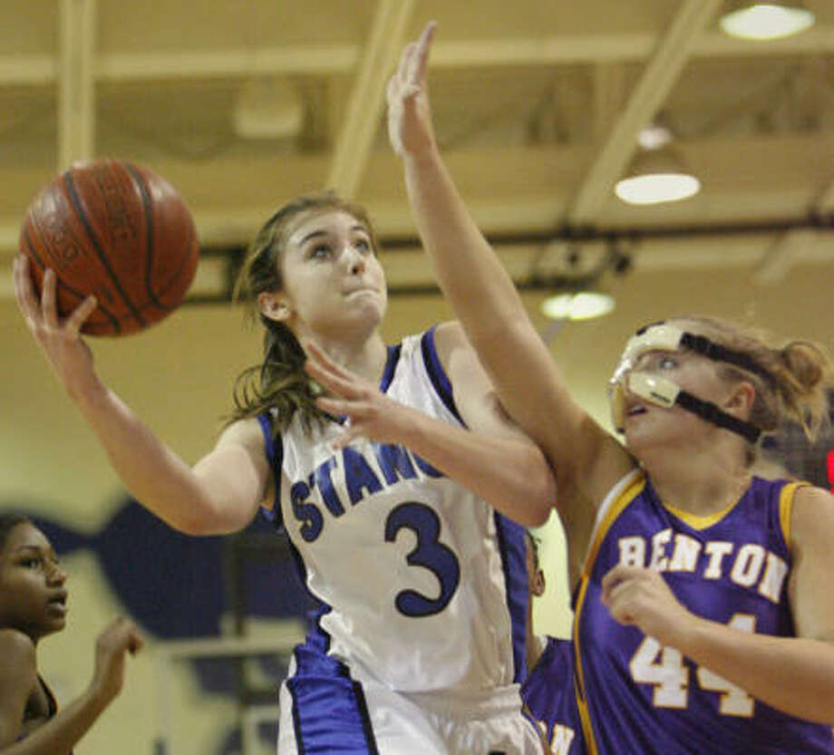 Katy Taylor's Ali Marzella (3) drives to the basket against Rachel Hall of Benton, La., during second-half action Thursday. Marzella scored 12 points to help Taylor win 42-24. Photo: Kevin Fujii, Chronicle