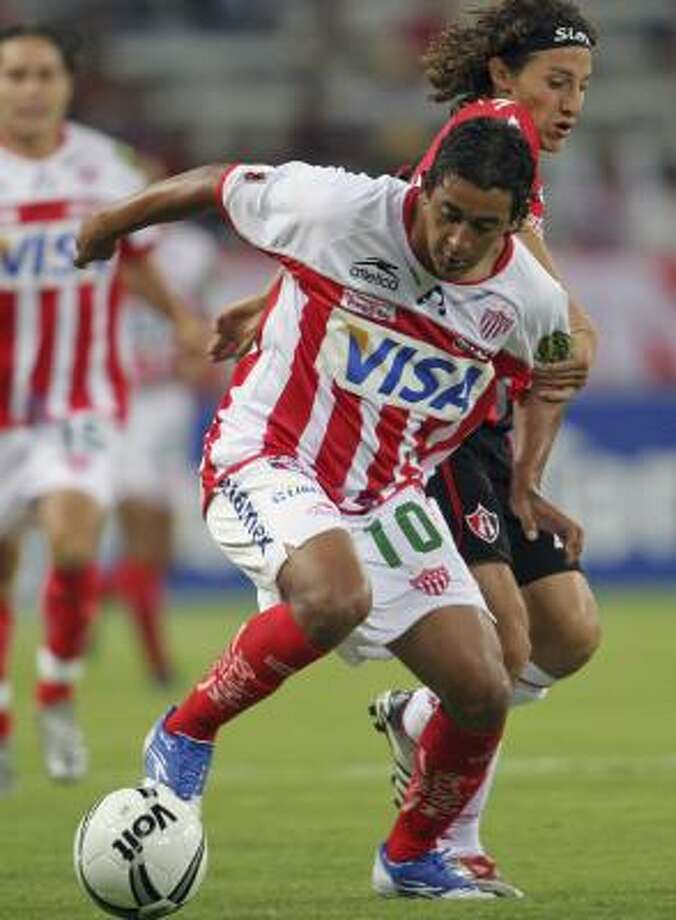 Necaxa (in red and white) is billeting its players near the Galleria. Photo: Chronicle File