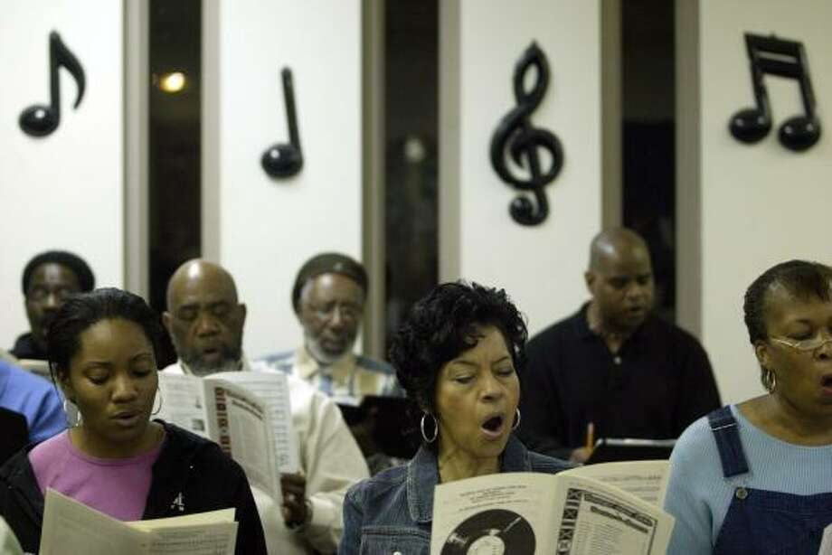 Members of the Houston Ebony Opera Guild rehearse for this weekend's downtown Houston performances. Photo: JESSICA KOURKOUNIS PHOTOS, FOR THE CHRONICLE