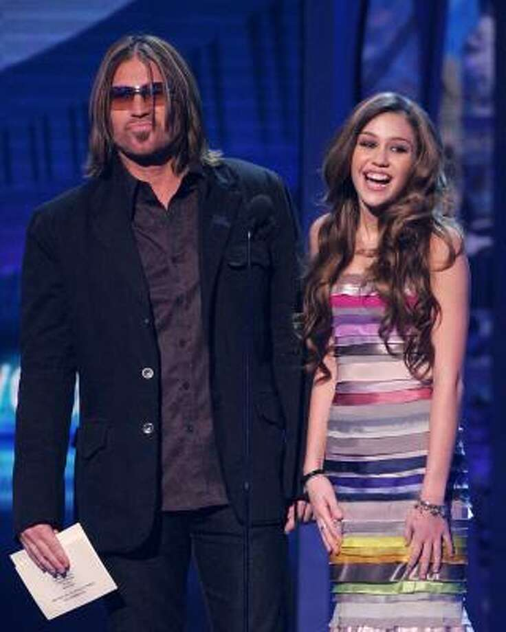 Billy Ray Cyrus, shown here with daughter Miley, is best known as a musician, but he also has appeared in several television shows. Photo: Scott Gries, Getty Images