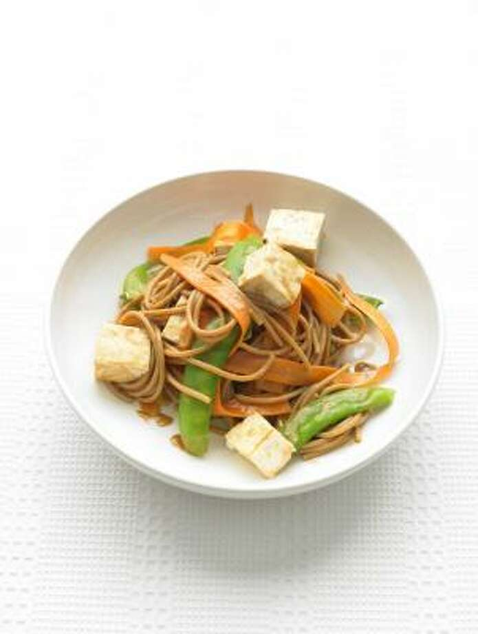 Though meatless, this Whole-Wheat Spaghetti With Vegetables and Peanut Sauce abounds in protein. Photo: JOSÉ MANUEL PICAYO RIVERA, EVERYDAY FOOD