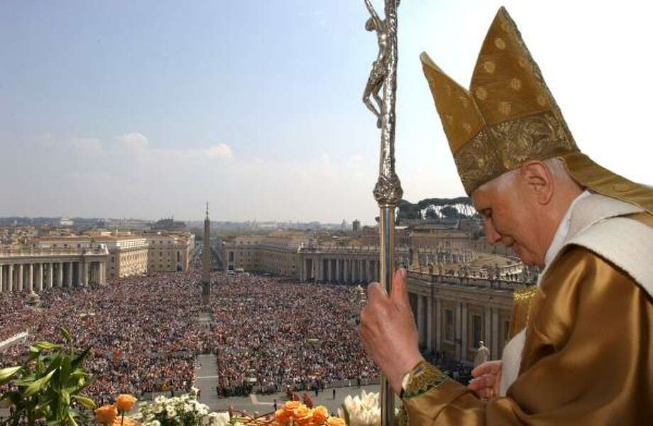 """Pope Benedict XVI delivers his traditional """"Urbi et Orbi"""" Easter address Sunday from the balcony at St. Peter's Basilica. Photo: Pool, L'OSSERVATORE ROMANO"""